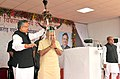 Narendra Modi being presented a traditional Bison-Horn Headdress of Maria Tribe by the Chief Minister of Chhattisgarh, Dr. Raman Singh in the Public Meeting, in Dantewada.jpg