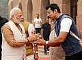 Narendra Modi being welcomed by the Minister of State for Youth Affairs and Sports (IC) and Information & Broadcasting, Col. Rajyavardhan Singh Rathore, on his arrival, to flag off 'Run for Unity'.jpg