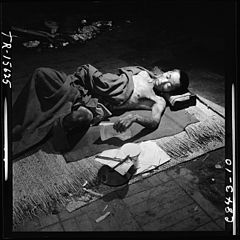 Navy photographer pictures suffering and ruins that resulted from atom bomb blast in Hiroshima, Japan. Victim lies in... - NARA - 520933.jpg