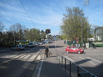 Nordenskiöldinkatu - Nordenskiöldinkatu, looking east from Mannerheimintie. To the right is the Helsinki Ice Hall, to the left, behind the trees, is the Laakso Hospital.