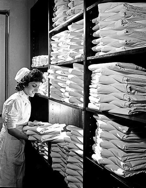 Nurse in Hospital Linen Closet, Pepperell Manufacturing Company (11179260584).jpg