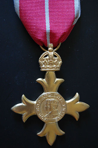 Nicolas Bodington - OBE - An Officer level of the Order of the British Empire (gold colour).