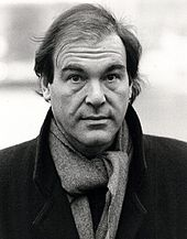 Black-and-white picture of Oliver Stone looking to the camera.