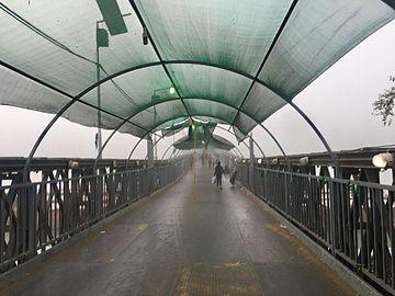 Pedestrian bridge under fog.jpg