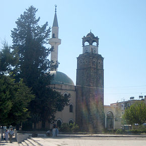 Mosque and clocktower in Peqin