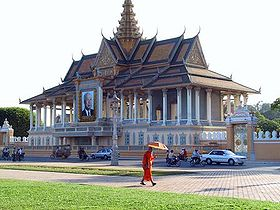 A Buddhist monk walking in front of the Royal palace in Phnom Penh.