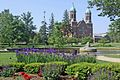 Photo of flowers, fountain, and the Chapel Building of Saint Joseph's College Summer 2011.jpg