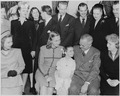 Photograph of Margaret O'Brien sitting between President Truman and Margaret Truman, as Bess Truman and assorted... - NARA - 199332.tif