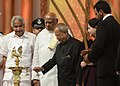 Pranab Mukherjee lighting the lamp at the Centenary Celebrations of Indian Cinema organized by the South Indian Film Chamber of Commerce, at Chennai, in Tamil Nadu. The Governor of Tamil Nadu, Dr. K. Rosaiah.jpg