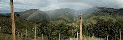Rainbow over oak trees in Acevedo, Huila, Colombia.jpg