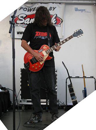 "Open G tuning - Zebra's Randy Jackson played ""Who's Behind The Door?"" using the same open-G overtones-tuning."