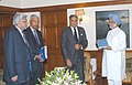 Ratan Tata presenting a report titled 'Investment Strategy for India' to the Prime Minister, Dr. Manmohan Singh, in New Delhi. The other members of the Commission Shri Deepak Parikh and Shri Ashok Ganguly are also seen.jpg