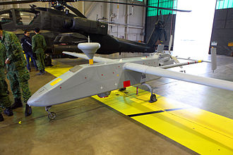 Republic of Singapore Air Force - Exercise Forging Sabre 2009, an RSAF's IAI Searcher II UAV parked inside the hangar of Henry Post Army Airfield, United States.