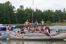 Troops lining up to compete in the Canoe Tug of War event. Two canoes are tied together and competing troops paddles as hard as they can to overpower the opponent canoe.