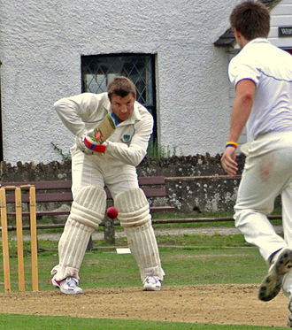 Rob Andrew - Representing Tilford Cricket Club at Elstead in 2010. Josh Berry the bowler