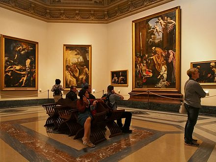 Tourists in the Pinacoteca Vaticana Room XII (17th century) of the Pinacoteca Vaticana.jpg