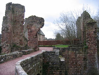 Roslin Castle - The approach to Roslin Castle over the bridge, and showing the east range behind the ruined gatehouse.