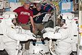 STS-134 EVA1 preparing in the Quest airlock.jpg