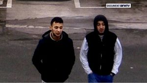 Brussels lockdown - Salah Abdeslam (L) and Hamza Attou (R) captured on CCTV at a French petrol station hours after the attacks.