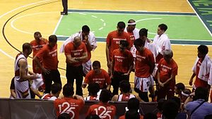 San Miguel Beermen - Leo Austria (center) in a San Miguel Beermen huddle during their game against NLEX on December 9, 2015.