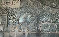 Scène de préparation des brochettes (bas-relief du Bayon) (2334493067).jpg