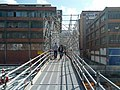 Scaffolding of pedestrian overpass over railroad undergrounding construction (18622870008).jpg