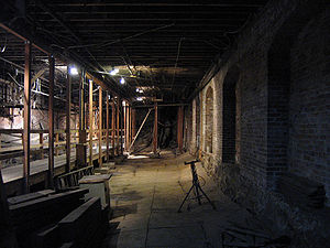 Seattle Underground - The concrete floor of the former meat market was originally at the level of the wooden platform on the left, but sank over time because of decomposing sawdust fill.