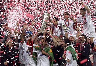players and staff of sevilla celebrating the uefa cup victory in