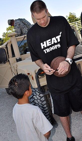 Shavlik Randolph - Shavlik Randolph signs a basketball for a young fan at Eglin Air Force Base in 2010