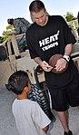 Shavlik Randolph signs basketball for young fan.jpg