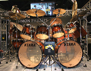 Cymbal stand - A Simon Phillips drum kit using straight, boom and multiple boom stands.