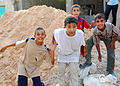 Small Iraqis with big smiles greet MND-B CG as he patrols area DVIDS111844.jpg