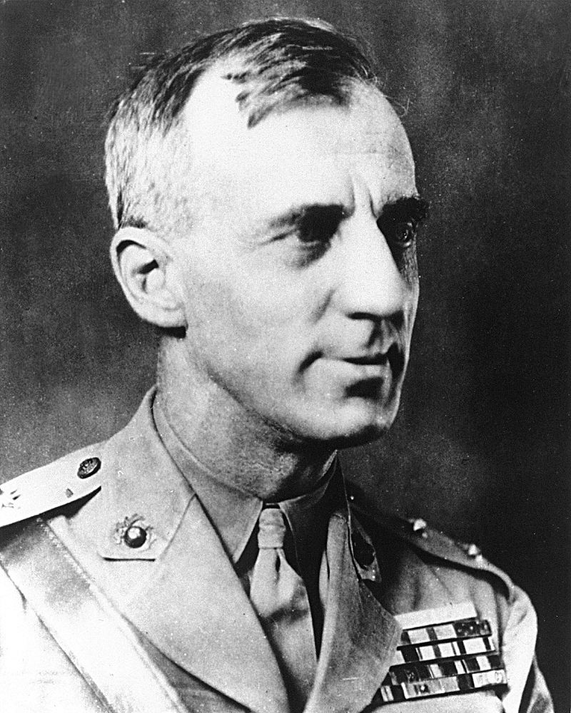 An adult male looking to the right in a military uniform; military ribbons are visible.