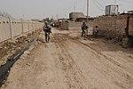 Soldiers, Iraqi national policemen distribute school supplies in Baghdad DVIDS157182.jpg
