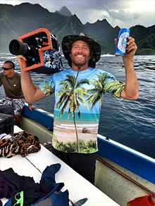 Sonny Miller enjoying a beer after a long filming session at Teahupoo