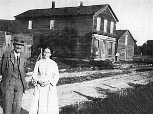 St. Johns, Ontario - Mr. and Mrs. F. N. Pitts in front of their store in St. Johns, 1919
