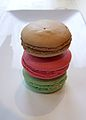 Stacked brown, pink and green macarons on a tray.jpg