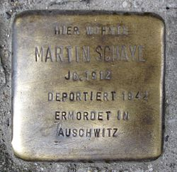 Photo of Martin Schaye brass plaque