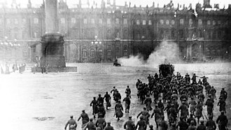 The Storming of the Winter Palace - Heavily retouched scene from the spectacle of 1920. This photograph was presented from 1922 on in many publications as an authentic depiction of the events, both in Russia and internationally.