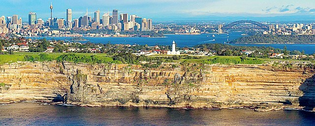 Sydney skyline as viewed from Tasman Sea, overlooking the clifftop suburb of Vaucluse.