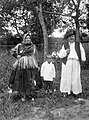 Tableau, man, woman, kid, garden, swing, pipe, folk costume Fortepan 13082.jpg