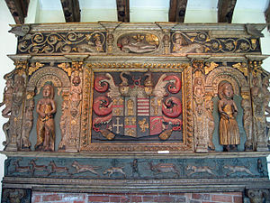Tabley House - Part of an ornately carved, painted and gilded, chimneypiece with female figures on the sides, and a coat of arms in the middle