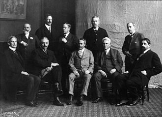 American Realism - The Ten American Painters in 1908. The 10 were Childe Hassam, J. Alden Weir, William Merritt Chase, Robert Reid, Willard Metcalf, Frank Weston Benson, Edmund Charles Tarbell, Thomas Wilmer Dewing, Joseph DeCamp, and Edward Simmons.