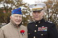 The Assistant Commandant of the Marine Corps, Gen. John M. Paxton, Jr., right, poses for a photo with a Marine veteran during an Honor Flight event at the Marine Corps War Memorial in Arlington, Va., Sept 131112-M-KS211-021.jpg