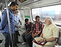 The Prime Minister, Shri Narendra Modi interacting with the co-passengers while travelling by the Delhi Metro to Faridabad on September 06, 2015.jpg