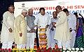 The Vice President, Shri M. Venkaiah Naidu lighting the lamp to inaugurate 'Swachhta Hi Sewa' and 'A Crusade for Toilets' Programmes under Swachh Bharat Abhiyan, at Konnur Village, Gadag District, Karnataka.jpg