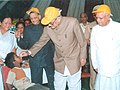 The Vice President Shri Bhairon Singh Shekhawat launches Pulse Polio Campaign in Uttaranchal by administering polio drops to the children at a medical camp in Dehradun on October 10, 2004.jpg