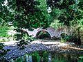 The three arches stone bridge of Paos River.jpg