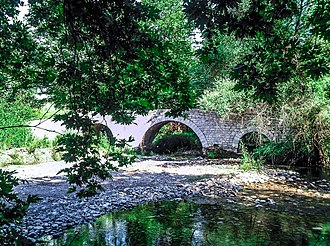 Paion - The three arches stone bridge of Paos River near Dafni