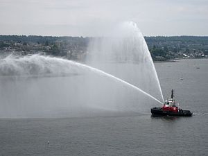 The tugboat Seaspan Raven shows off her firefighting monitors in English Bay.jpg